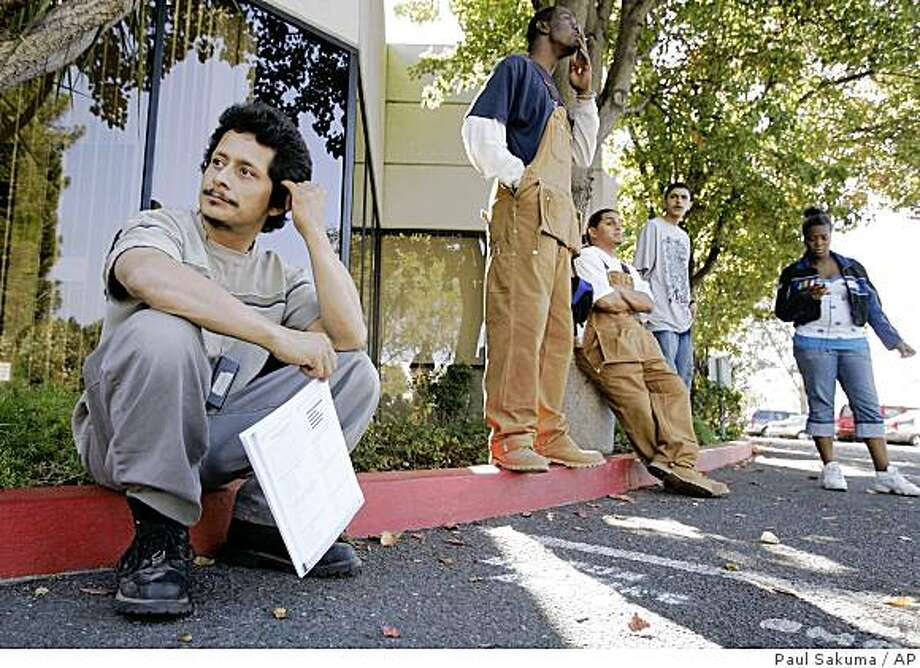 Unemployed auto mechanic Lorenzo Avila, left, sits during a break from a training session at JobTrain, a non-profit vocational training and job placement center in Menlo Park, Calif., Thursday, Oct. 23, 2008. New claims for jobless benefits increased by more than expected last week, the Labor Department said Thursday.  (AP Photo/Paul Sakuma) Photo: Paul Sakuma, AP