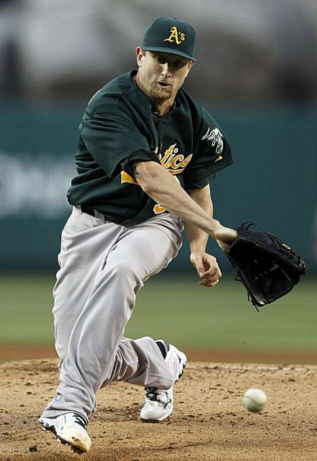 Oakland Athletics starting pitcher Dallas Braden fails to get a glove on a ball hit by Los Angeles Angels' Howard Kendrick during the first inning of a baseball game in Anaheim, Calif., Friday, May 14, 2010. Kendrick was out on the play. Photo: Chris Carlson, AP