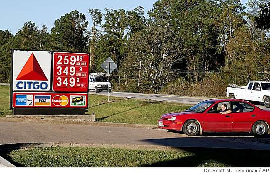Gas prices are shown in Kingwood, Texas, on Saturday, October 18, 2008. A gallon (3.8 liters) of regular gasoline fell .049 cents overnight to a new national average of $2.991, according to auto club AAA, the Oil Price Information Service and Wright Express. Prices have not been below $3 nationally since Feb. 16. Saturday's price is slightly above the national average price of $2.81 a year ago, but 27 percent lower than the all-time high of $4.114 reached July 17. Before Saturday, gas prices already were below $3 in 23 states, according to AAA.  (AP Photo/Dr. Scott M. Lieberman) Photo: Dr. Scott M. Lieberman, AP