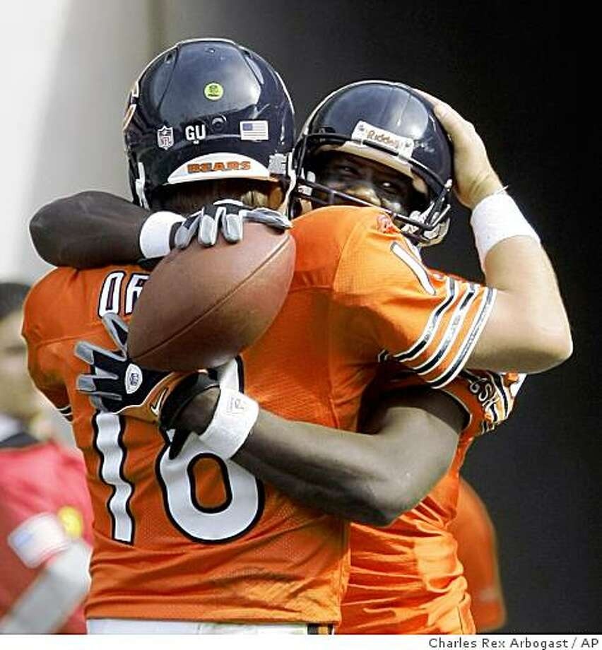 Chicago Bears quarterback Kyle Orton (18) celebrates with wide receiver Marty Booker after they connected on a 51-yard touchdown pass during the third quarter of an NFL football game against the Minnesota Vikings in Chicago, Sunday, Oct. 19, 2008. The Bears won 48-41. (AP Photo/Charles Rex Arbogast) Photo: Charles Rex Arbogast, AP