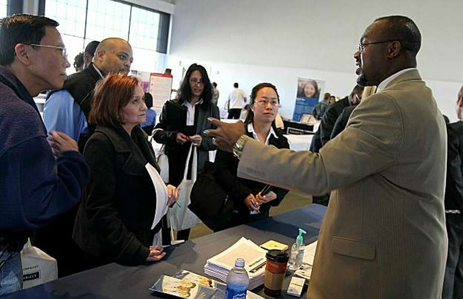 SAN FRANCISCO - MAY 12:  A recruiter talks with job seekers during a job fair held by the California Employment Development Department and the San Francisco Veterans Employment Committee May 12, 2010 in San Francisco, California. Hundreds of job seekers attended the one-day job fair as the national unemployment rate sits at 9.9 percent. Photo: Justin Sullivan, Getty Images