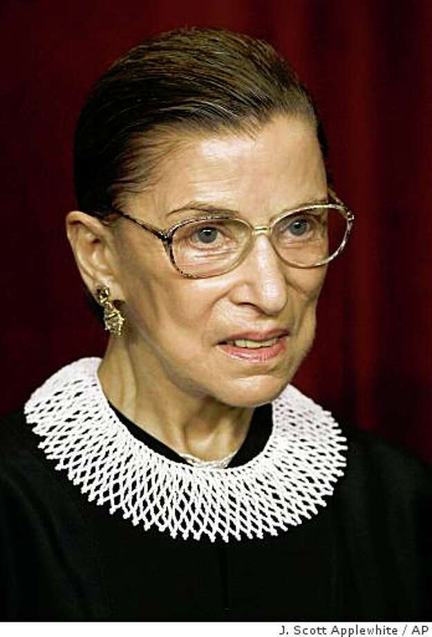Associate Justice Ruth Bader Ginsburg joins the members of the Supreme Court for photos during a group portrait session, at the Supreme Court Building in Washington, Friday, March 3, 2006.. President Clinton nominated her as an Associate Justice of the Supreme Court, and she took her seat Aug. 10, 1993. (AP Photo/J. Scott Applewhite)Ran on: 03-19-2006 Photo: J. Scott Applewhite, AP