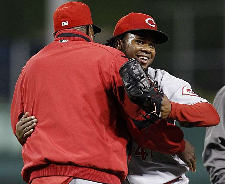 Cincinnati Reds pitcher Johnny Cueto, right, gets a hug from Reds manager Dusty Baker after getting the final out in the ninth inning against the Pittsburgh Pirates in a baseball game in Pittsburgh Tuesday, May 11, 2010. Cueto pitched a complete game, one-hit, shutout with the Reds winning 9-0. Photo: Gene J. Puskar, AP
