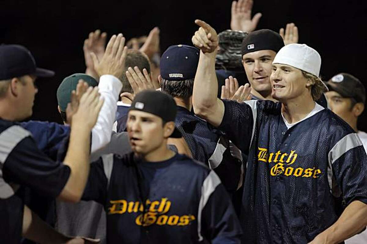 Eric Byrnes and his team, the Dutch Goose, high five the players from the Vintage Construction softball team. Byrnes, the former A's outfielder who is from the Peninsula, recently was released by the Seattle Mariners. He's come home and is playing in a recreational softball league, for the Dutch Goose team in Menlo Park, Calif., on Wednesday, May 12, 2010.
