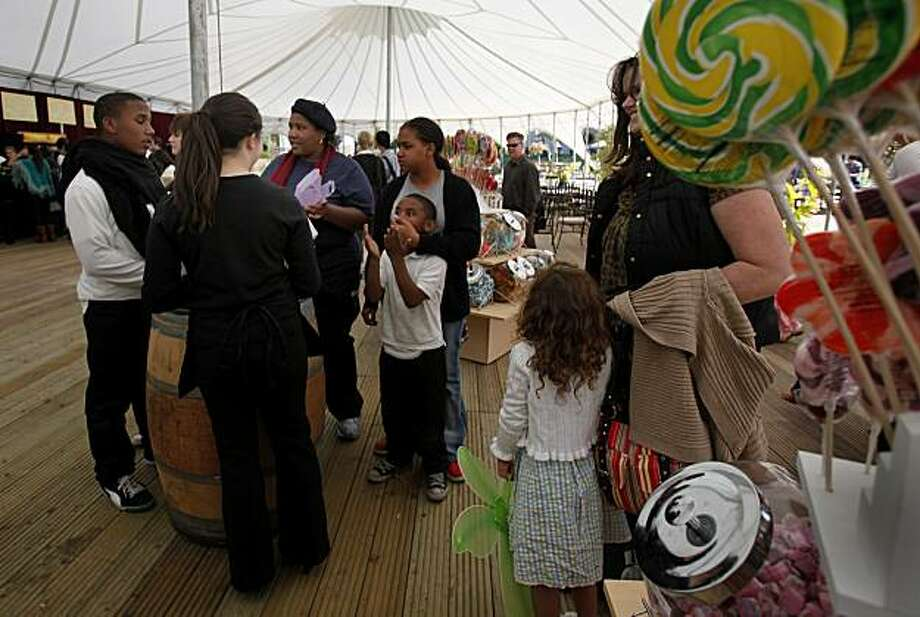 "In the souvenir area, children are given boxes to pick out candy they like. ""Peter Pan"" with wrap-around productions inside a 360 degree tent in San Francisco, Calif. is about to make its U.S. debut. Photo: Brant Ward, The Chronicle"