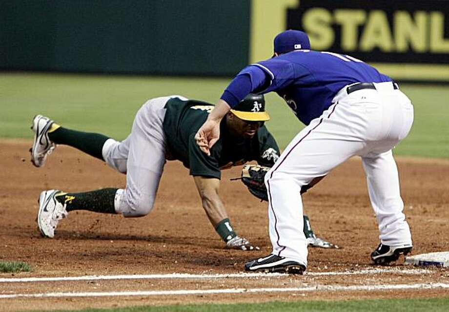 Oakland Athletics' Rajai Davis is tagged out by Texas Rangers Justin Smoak after a pickoff throw from pitcher Derek Holland during a Major Baseball Game at Rangers Ballpark in Arlington, Texas, Wednesday, May 12, 2010. (Richard W. Rodriguez/Fort Worth Star-Telegram/MCT) Photo: Richard W. Rodriguez, MCT