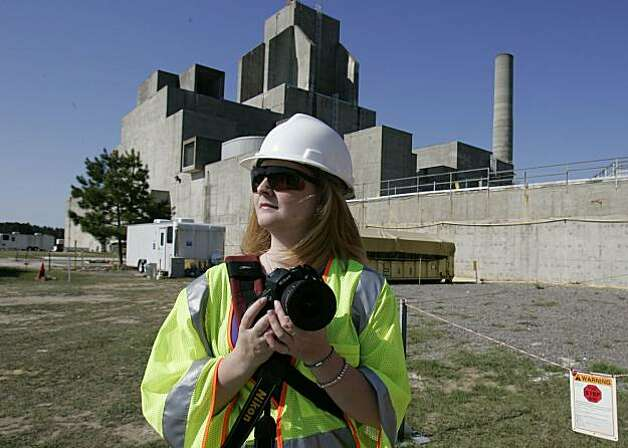 Megan Elliot,26, uses her camera to document the decomissioning of the P-Reactor at the Savannah River Site Monday April 12, 2010, near New Ellenton, S.C. About $1.6 billion in stimulus cash was used to create 3,100 temporary jobs in a rural corner of thestate cleaning up the Savannah River Site, which already employed about 9,000 and churned out radioactive metals for the nation's nuclear arsenal during the Cold War. Photo: Mary Ann Chastain, AP