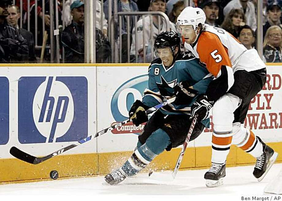 Philadelphia Flyers' Braydon Coburn (5) and San Jose Sharks' Joe Pavelski (8) fight for the puck during the second period of an NHL hockey game Saturday, Oct. 18, 2008, in San Jose, Calif. (AP Photo/Ben Margot) Photo: Ben Margot, AP