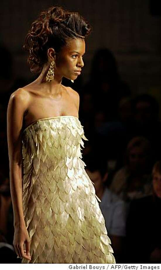 A model presents a creation by Joseph Domingo during the Spring Fashion week in Culver City, California, on October 14, 2008.  AFP PHOTO / GABRIEL BOUYS (Photo credit should read GABRIEL BOUYS/AFP/Getty Images) Photo: Gabriel Bouys, AFP/Getty Images