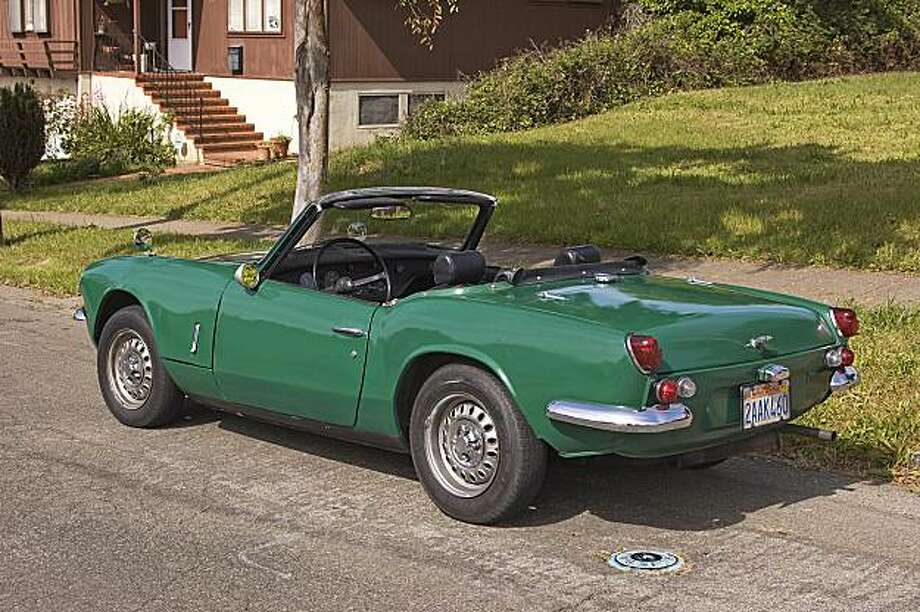 Darrell Caraway says his 1969 Triumph Spitfire convertible is a perfect car for him because it gets great gas mileage and is easy to park. Photo: Stephen Finerty