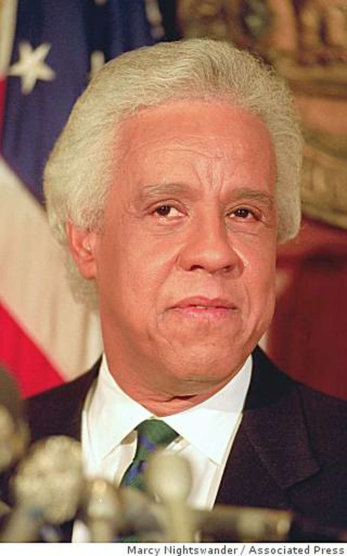 Former Gov. L. Douglas Wilder, shown in this 1992 file photo, abandoned his independent run for the the Senate Thursday, Sept. 15, 1994 after two polls showed him far behind his fellow Democrat and longtime rival, Sen. Charles S. Robb. Wilder's withdrawl reduced the chance that a split among Democrats would hand the seat to conservative Republican Oliver North. (AP Photo/File, Marcy Nightswander)