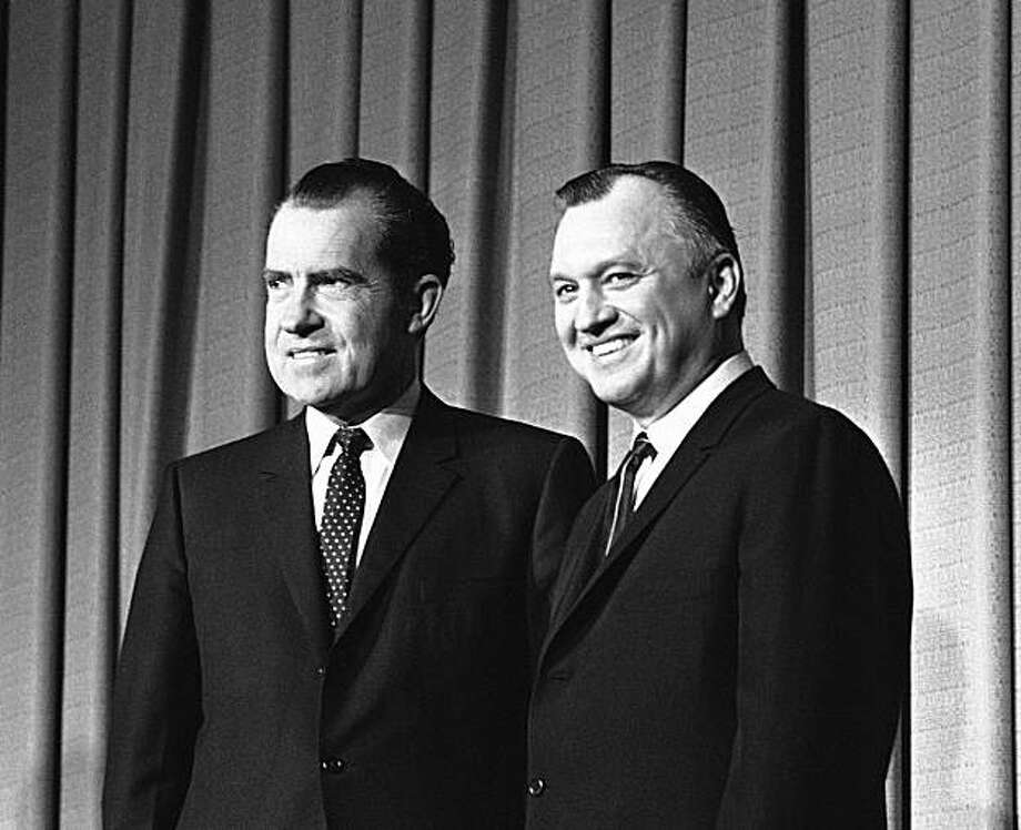 FILE - In this file photo from Dec. 11, 1968, President Richard Nixon, left, is shown with Secretary of Interior Walter J. Hickel at Nixon's announcement of cabinet in Washington. Hickel, who was Richard Nixon's interior secretary until he was fired aftercriticizing the handling of Vietnam protests, died Friday night May 7, 2010 at Horizon House, an assisted living facility in Anchorage.. He was 90. Photo: AP