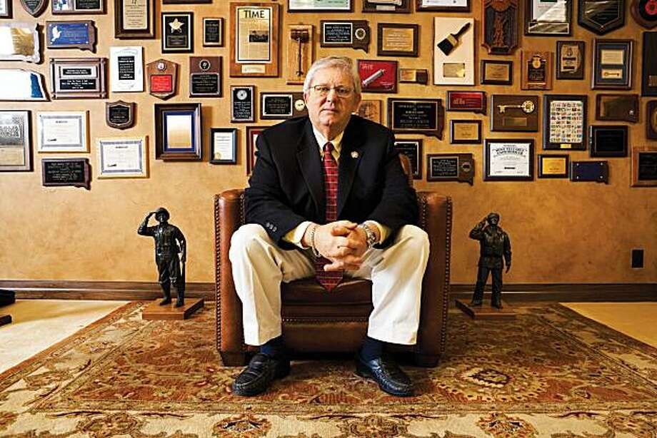 William Janklow, former governor of South Dakota, poses in his law office crowded with mementos from his 16 years as a Republican governor, in Sioux Falls, South Dakota, U.S., on March 24, 2009. Janklow is the politician who, in 1981, brought Citibank to South Dakota. Photographer: Thomas Strand/Bloomberg Markets via Bloomberg EDITOR'S NOTE: IMAGE AVAILABLE FOR ONE-TIME USE ONLY TO ACCOMPANY BLOOMBERG MARKETS MAGAZINE STORY, CREDIT CARDS, BY LISA KASSENAAR. EDITORIAL USE ONLY. NO SALES. NO ARCHIVING. Photo: Thomas Strand, Via Bloomberg