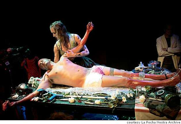 "La Pocha Nostra performer Roberto Sifuentes plays a bloodied ""universal immigrant,'' being cared for by a woman played by Norwegian Ingvild Holthe Bygdnes (cq), in a performance of ""Mapa/Corpo'' in Harstad, Norway last year. Photo: Courtesy La Pocha Nostra Archive"