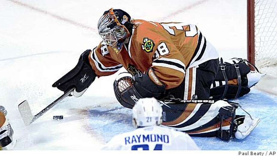 Chicago Blackhawks goalie Cristobal Huet makes a save against the Vancouver Canucks during the first period in Chicago, Sunday, Oct. 19, 2008. Photo: Paul Beaty, AP
