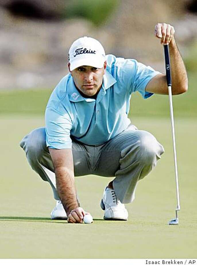 Marc Turnesa lines up his putt on the sixth green during the third round of the Justin Timberlake Shriners Hospitals for Children Open golf tournament at TPC Summerlin in Las Vegas on Saturday, Oct. 18, 2008. Turnesa shot a 3-under-par 69. (AP Photo/Isaac Brekken) Photo: Isaac Brekken, AP
