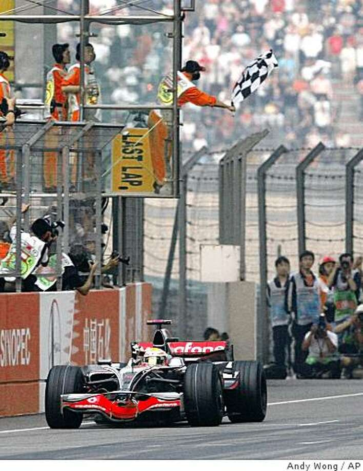 McLaren Mercedes driver Lewis Hamilton of Britain crosses the finish line to win the Chinese Formula One Grand Prix at the Shanghai Circuit, in Shanghai, China Sunday Oct. 19, 2008. (AP Photo/Andy Wong) Photo: Andy Wong, AP