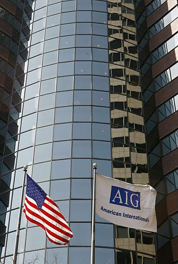 FILE - In this March 17, 2009 file photo, an AIG office building is shown in New York. American International Group is reporting net income of $1.45 billion for the first quarter as markets stabilized and the insurance giant avoided cutting the value of its assets. Photo: Mark Lennihan, AP