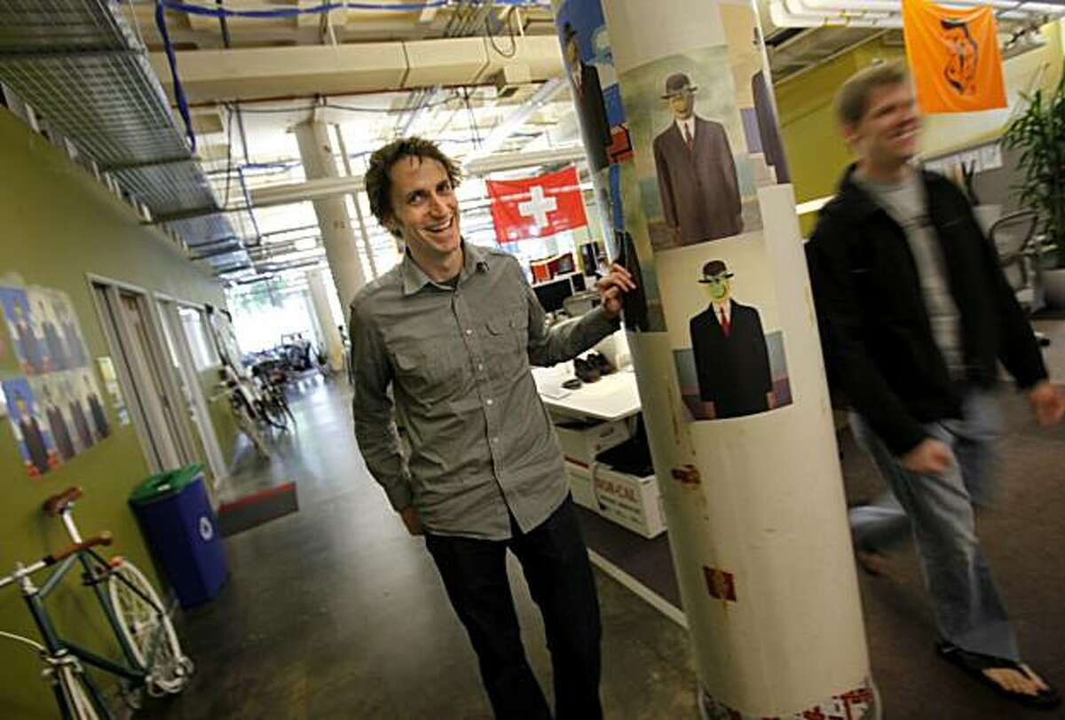 Cameron Marlow (left) pauses in a hallway near his workstation at Facebook and laughs when a co-worker walks by. Cameron Marlow at work on the Facebook campus Thursday April 15, 2010 in Palo Alto, Calif. Cameron Marlow is a research scientist and in-house social scientist at Facebook.