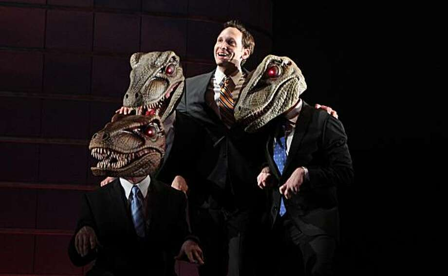 "In this theater publicity image released by Jeffrey Richards Associates, Stephen Kunken perform with actors wearing raptor masks in a scene from Lucy Prebble's docudrama ""Enron,"" now playing at Broadway's Broadhurst Theatre in New York. Kunken portrays Enron CFO Andy Fastow. Photo: Joan Marcus, AP"