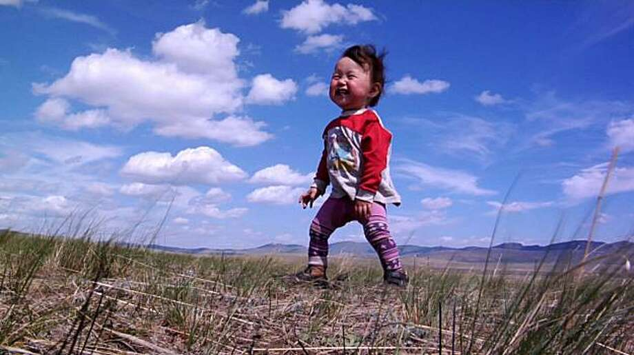 "In this film publicity image released by Focus Features, a Mongolia child named  Bayarjargal is shown in a scene from the film, ""Babies."" Photo: AP"