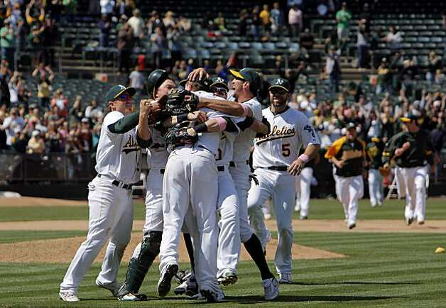 The Oakland Athletics mob pitcher Dallas Braden after his perfect game against the Tampa Bay Rays in Oakland on Sunday. Photo: Carlos Avila Gonzalez, The Chronicle