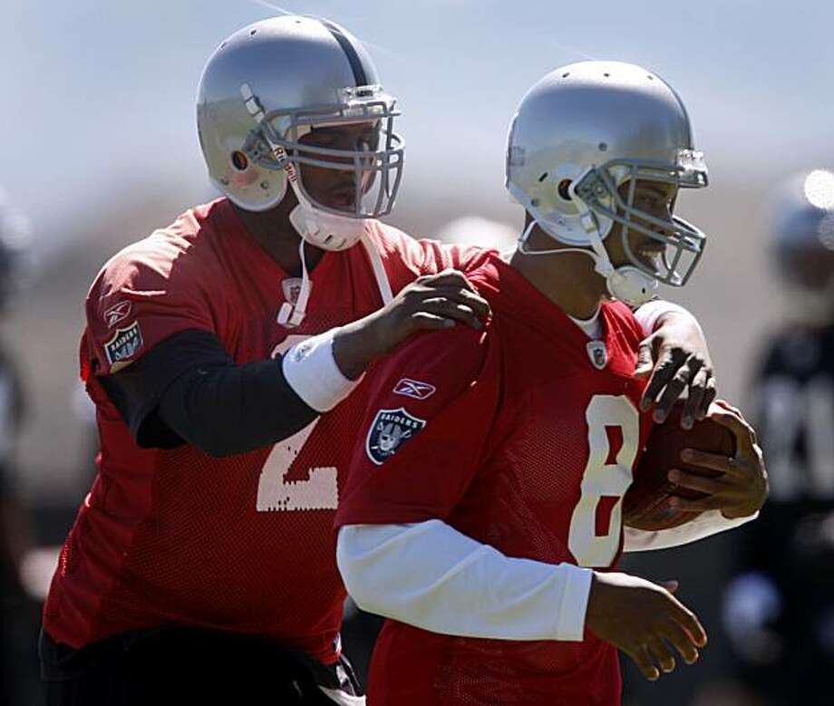 JaMarcus Russell grabs recently acquired Jason Campbell during a quarterbacks drill at Oakland Raiders minicamp in Alameda, Calif., on Friday, April 30, 2010. Photo: Paul Chinn, The Chronicle