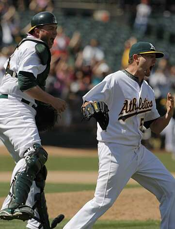 Dallas Braden, right, and Landon Powell react to Braden's perfect game as the last out is tallied Sunday against the Tampa Bay Rays in Oakland. Photo: Carlos Avila Gonzalez, The Chronicle