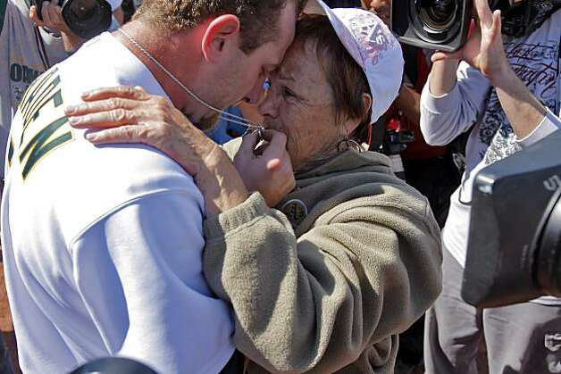 Dallas Braden celebrates with his grandmother, Peggy Lindsey of Stockton, after pitching a perfect game on Mother's Day. Braden's mother has passed away and his grandmother attended the game. The chain around Braden's neck is a memento of his mother that used to hold her wedding ring until he lost it years ago. He has worn it for years and when it has broken, he's held it together with paper clips and safety pins, Lindsey said. Photo: Carlos Avila Gonzalez, The Chronicle
