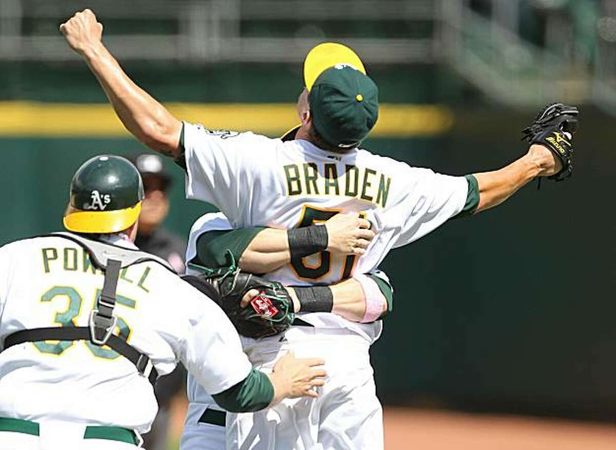 Dallas Braden of the Oakland Athletics celebrates after pitching a perfect game against the Tampa Bay Rays on Sunday in Oakland.