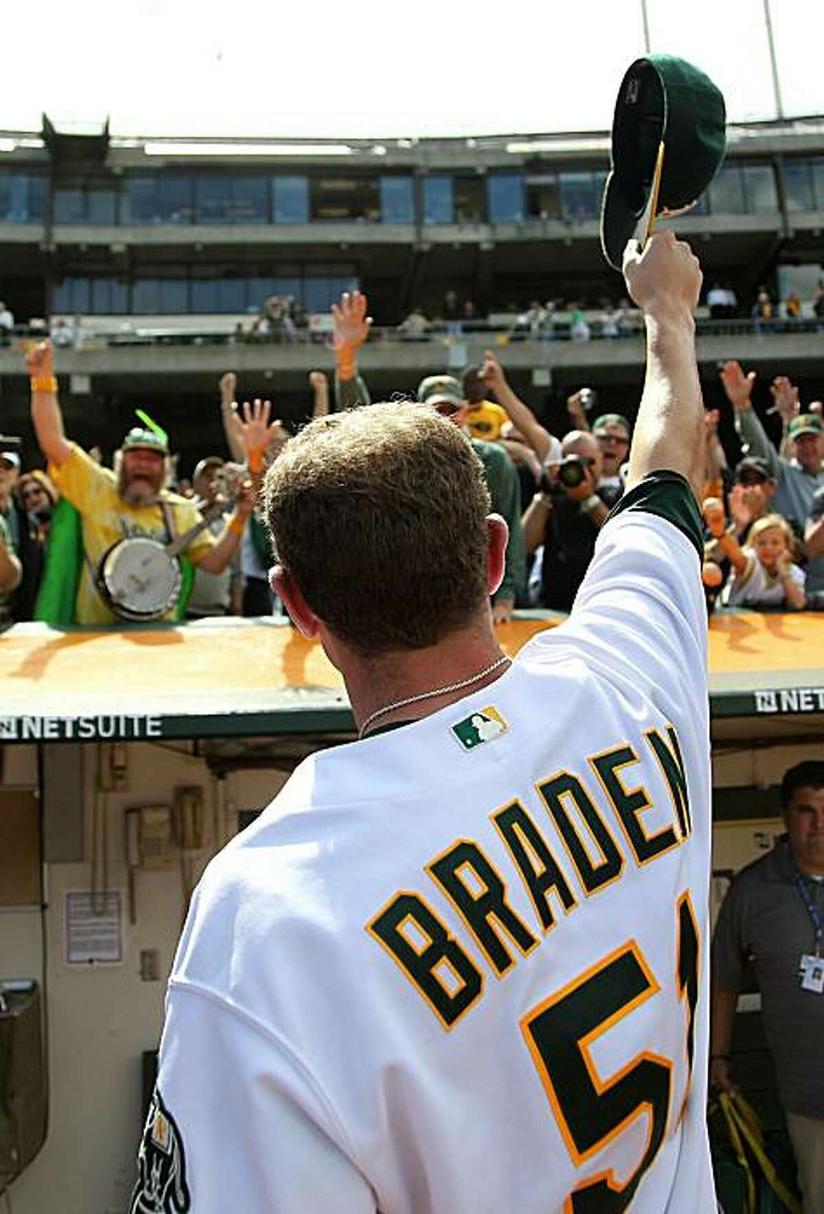Dallas Braden celebrates after pitching a perfect game against the Tampa Bay Rays on Sunday in Oakland.