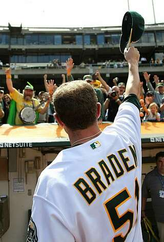 Dallas Braden celebrates after pitching a perfect game against the Tampa Bay Rays on Sunday in Oakland. Photo: Jed Jacobsohn, Getty Images