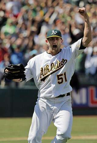 Oakland Athletics starting pitcher Dallas Braden celebrates throwing a perfect game against the Tampa Bay Rays in Oakland on Sunday. Braden pitched the 19th perfect game in major league history. Photo: Carlos Avila Gonzalez, The Chronicle