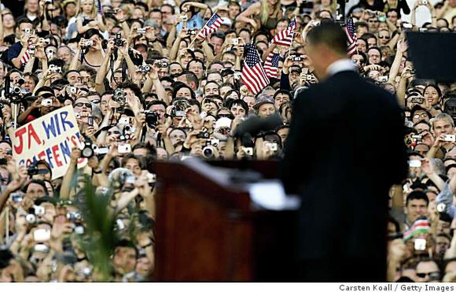BERLIN - JULY 24:  Presumptive U.S. Democratic presidential candidate Sen. Barack Obama (D-IL) speaks in front of the Siegessaeule at the Grosser Stern in Tiergarten on July 24, 2008 in Berlin, Germany.  According to reports, police confirmed that about 200,000 people attended the speech by Obama on the historic U.S.-German partnership and the need to strengthen transatlantic relations to meet 21st century challenges.  (Photo by Carsten Koall/Getty Images) Photo: Getty Images