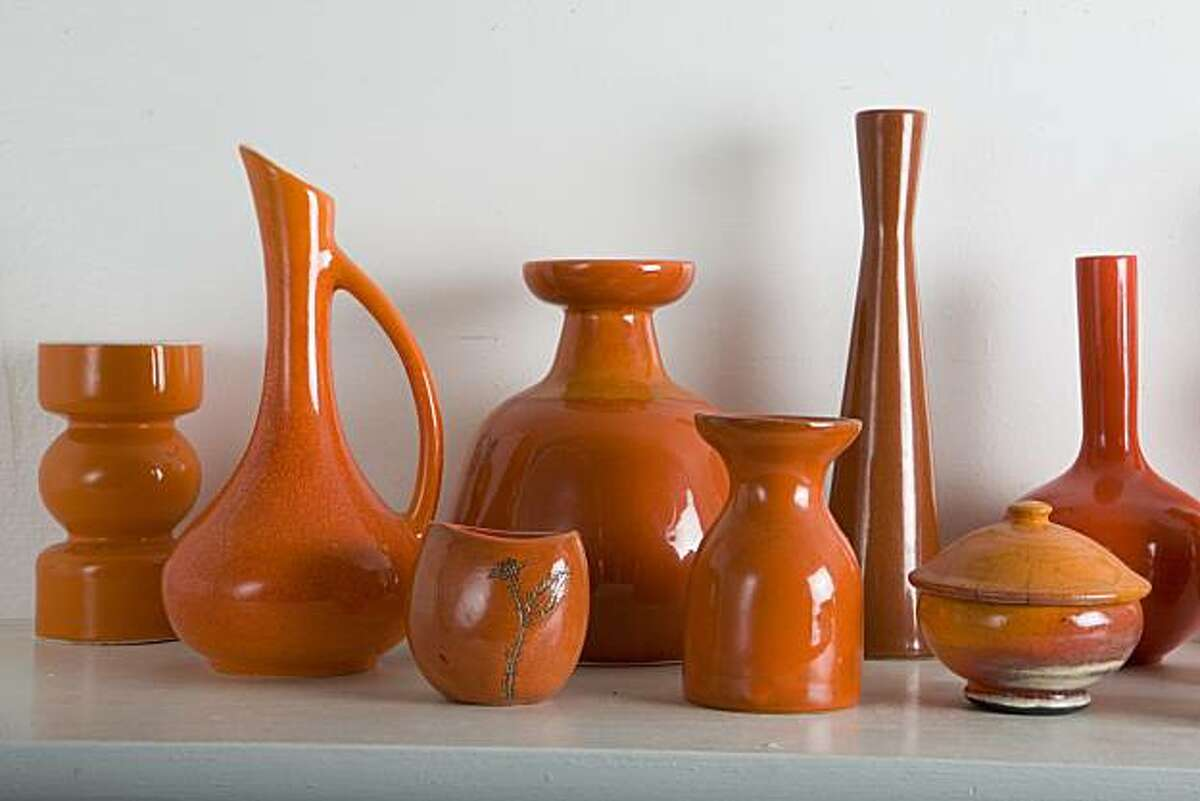 A portion of artist Lisa Congdon's orange pottery collection in the living room of her San Francisco, Calif. home on Wednesday, March 24, 2010. Kat Wade / Special to the Chronicle
