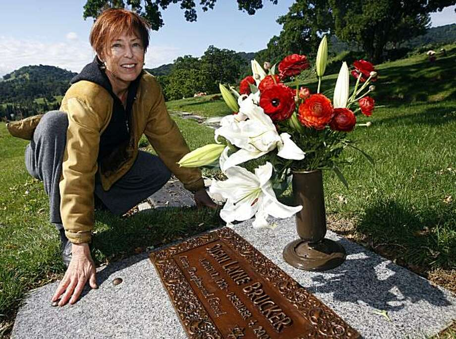 Oakland-based sculptor Sigrid Herr tends to a grave marker she recently designed for a client at Oakmont Memorial Park  in Lafayette, Calif., on Wednesday, April 28, 2010. Photo: Paul Chinn, The Chronicle