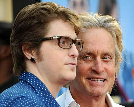 "(FILES)Actor Michael Douglas arrives with his son Cameron Douglas for the world premiere of ""Ghosts of Girlfriends Past"" at the Grauman's Chinese Theater in Hollywood, California, on April 27, 2009. A New York City judge sentenced Cameron Douglas on April20, 2010 to five years in prison for dealing methamphetamine and cocaine. Photo: Gabriel Bouys, AFP/Getty Images"