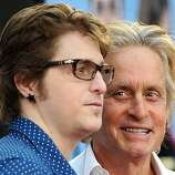 "(FILES)Actor Michael Douglas arrives with his son Cameron Douglas for the world premiere of ""Ghosts of Girlfriends Past"" at the Grauman's Chinese Theater in Hollywood, California, on April 27, 2009. A New York City judge sentenced Cameron Douglas on April20, 2010 to five years in prison for dealing methamphetamine and cocaine."