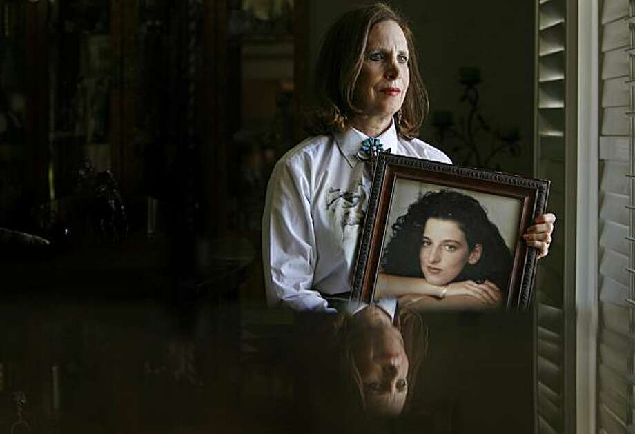 Chandra's mother, Susan Levy in her Modesto home, with a photograph of her daughter. More than 6 years after the death of 25 year old, Federal Intern Chandra Levy in Washington DC the murder is still unsolved. Representative Gary Condit of Modesto was for a very long time a person of interest in the case but never charged. Condit never returned to politics and the killer of Chandra Levy  has never been found. Photographed in, Modesto, Ca, on 5/19/07.   Photo by: Michael Macor/ The Chronicle Photo: Michael Macor, The Chronicle