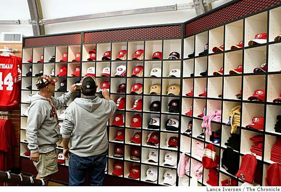 Customers look at hats at the Team Store prior to the 49er-Eagles game at Candlestick Park on Sunday October 12, 2008 in San Francisco Calif. Photo: Lance Iversen, The Chronicle
