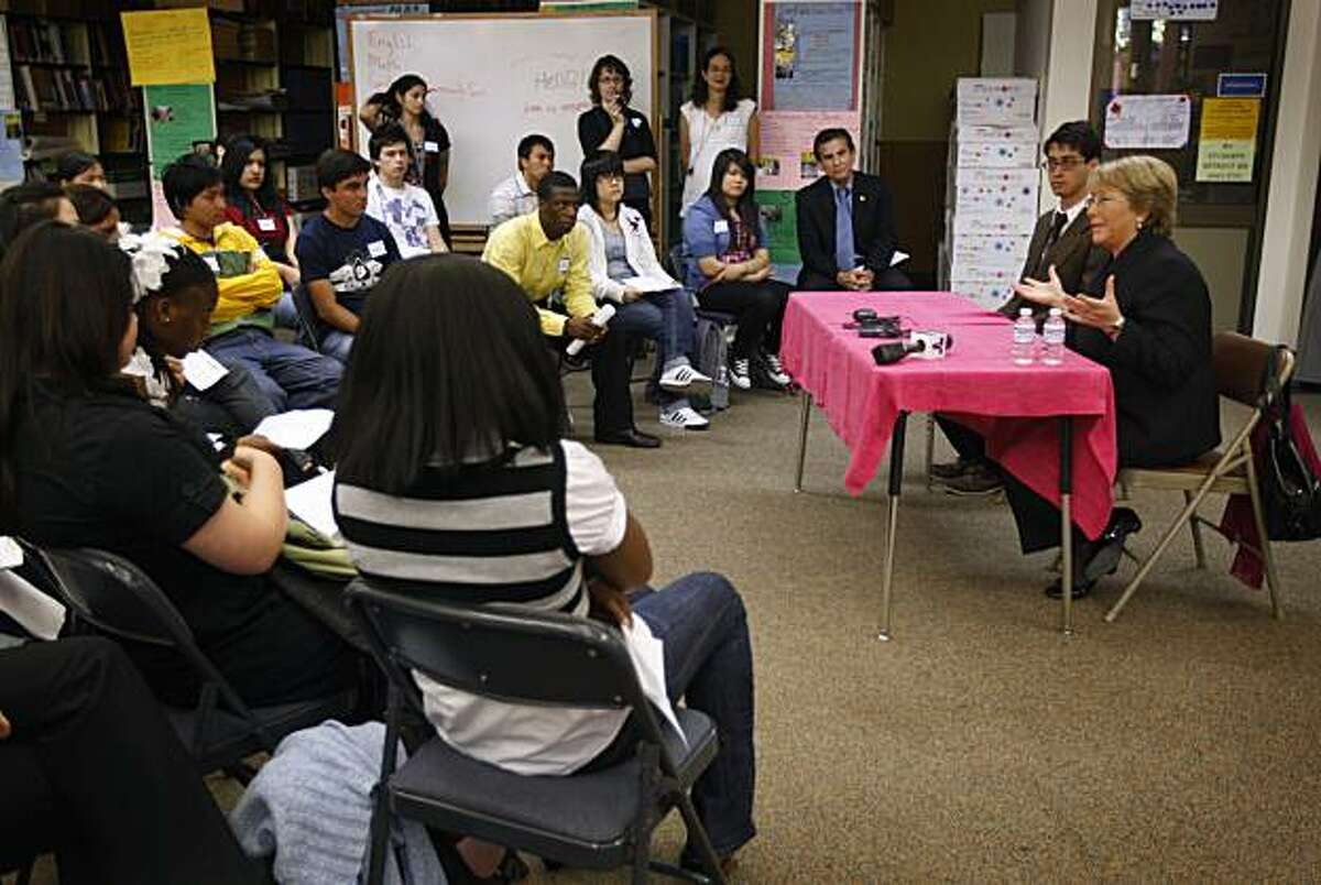The former president of Chile, Michelle Bachelet (right), visits with seniors at Oakland International High School in Oakland, Calif., on Wednesday, May 5, 2010.