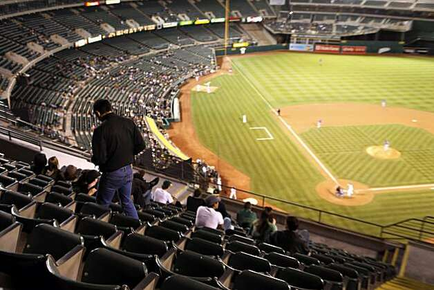 In years past, A's management reduced the size of the coliseum by placing tarps over the seats in the third level except for a small section behind home plate. The A's attendance is abysmal as illustrated by the lack of fans at the game against the Texas Rangers. The Oakland Athletics played the Texas Rangers at the Oakland-Alameda County Coliseum in Oakland, Calif., on Monday, May 3, 2010. The Rangers won 4-2. Photo: Carlos Avila Gonzalez, The Chronicle
