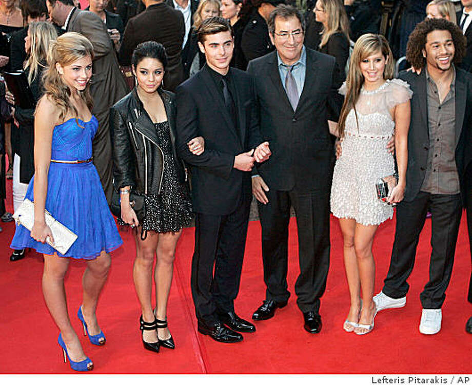 U.S. actors, from left, Jemma McKenzie-Brown, Vanessa Anne Hudgens, Zac Efron, director Kenny Ortega, Ashley Tisdale and Corbin Bleu arrive for the British premiere of their latest film, 'High School Musical 3' at a central London cinema, Tuesday Oct. 7, 2008. (AP Photo/Lefteris Pitarakis) Photo: Lefteris Pitarakis, AP