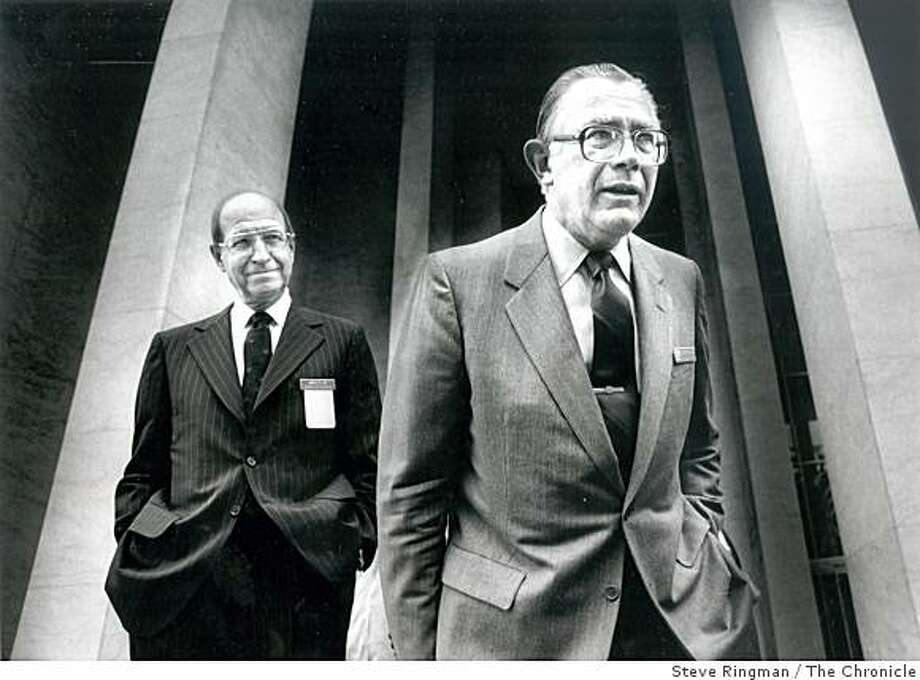 James Lee (left) head of Gulf Oil, stands with George Keller, chairman of Standard Oil Company on the steps of the Masonic Auditorium April 30, 1984. Keller, who as chairman of the Standard Oil Company of California in the 1980s executed what was then the largest corporate takeover ever, a deal in which Standard Oil swallowed Gulf Oil to form an even bigger oil company, Chevron, died Friday, Oct. 17, 2008, in Palo Alto, Calif. Photo: Steve Ringman, The Chronicle