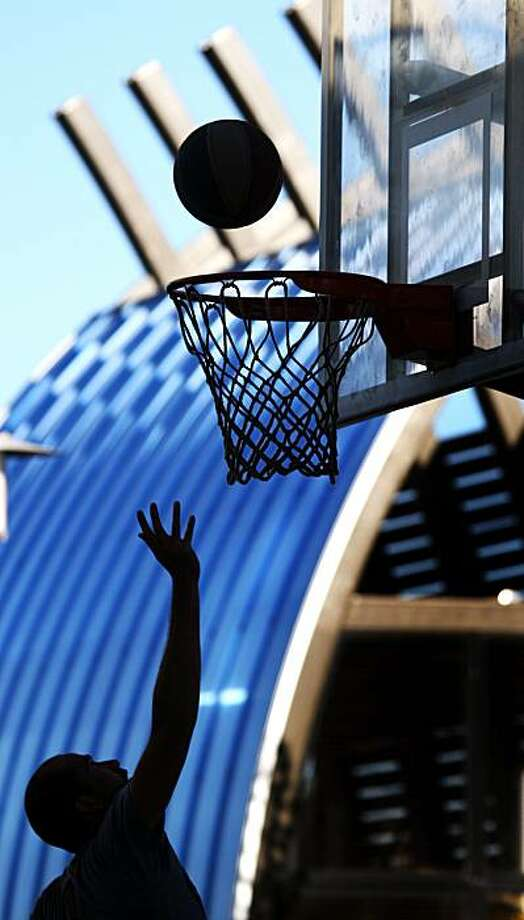 J.R. Fieser plays basketball in the shadows of The Kayak Shed at Mission Creek Park in San Francisco October 16, 2008. Photo: Lance Iversen, The Chronicle