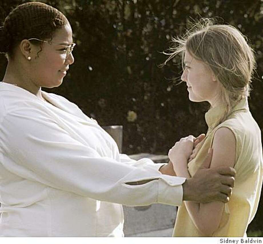 Queen Latifah and Dakota Fanning in Secret Life of Bees. Photo: Sidney Baldwin