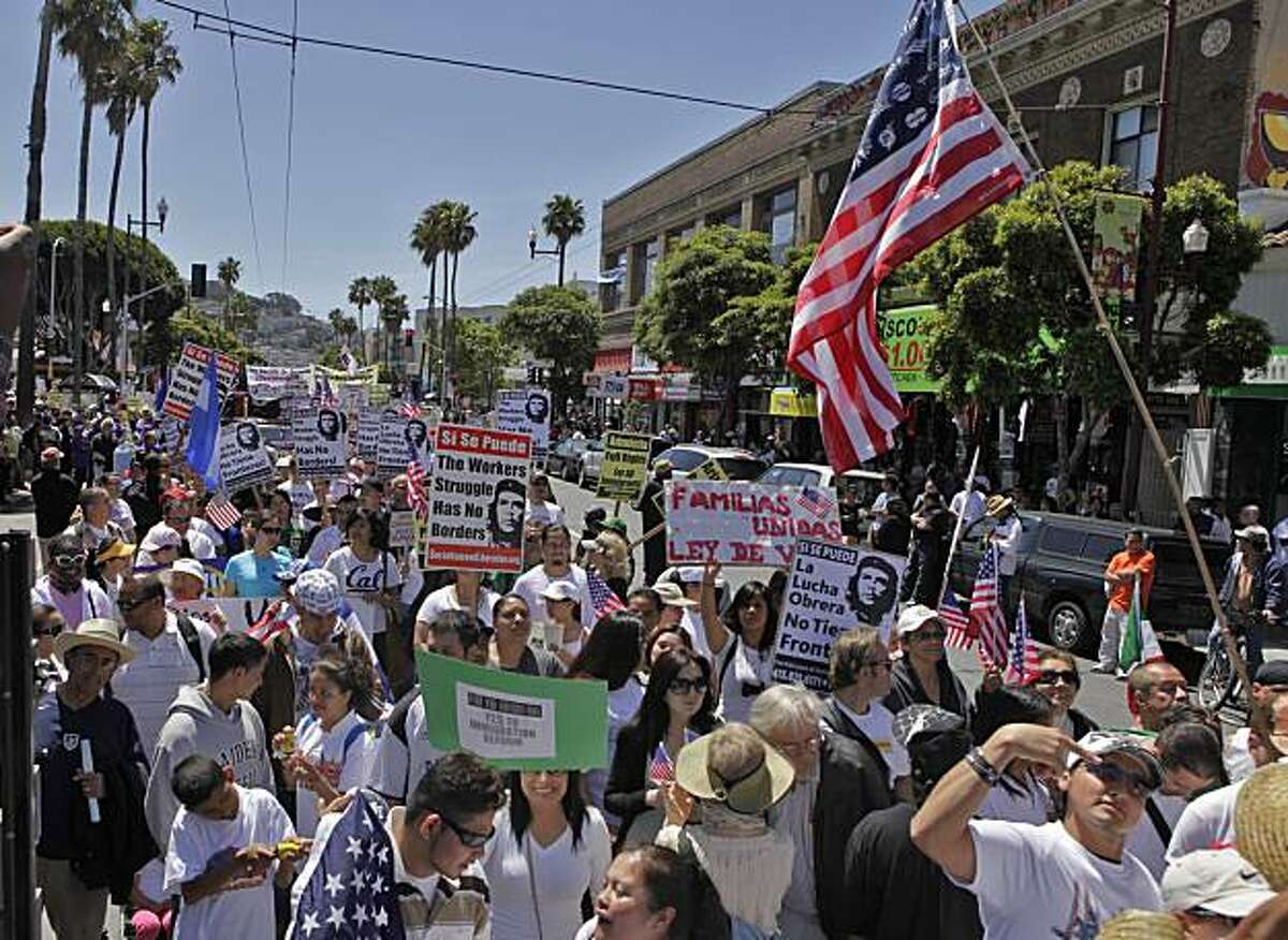 Thousands of people march through the Mission District to Civic Center on Saturday in San Francisco.