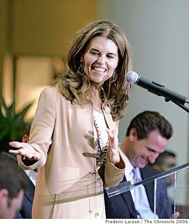 Maria Shriver with SF Mayor Gavin Newson in background speaks during the grand opening ceremories of a new mall and Bloomingdale's store, opening 9/28/06 in downtown San Francisco that will lure big crowds to the shops, restaurants and movie theaters. But visitors also could encounter traffic jams and parking shortages -- at least during the holidays and big events at Moscone Center. Photo: Frederic Larson, The Chronicle 2006