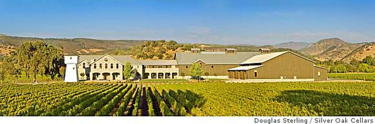 """The new Napa Valley home of Silver Oak Cellars includes discreet solar panels and a limestone facade """"recycled"""" from an abandoned flour mill in Kansas."""