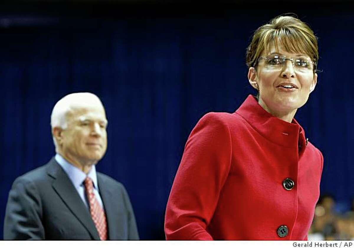 ** FILE ** Republican presidential candidate, Sen. John McCain, R-Ariz., and vice presidential candidate, Alaska Gov. Sarah Palin, campaign at a Capital University rally in Columbus, Ohio, Monday, Sept. 29, 2008. (AP Photo/Gerald Herbert)